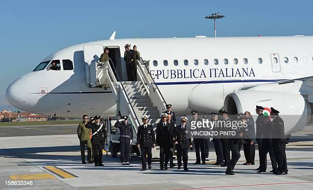 Italian marines Massimiliano Latorre and Salvatore Girone arrive with Admiral Luigi Binelli Mantelli at Ciampino airport near Rome on December 22...