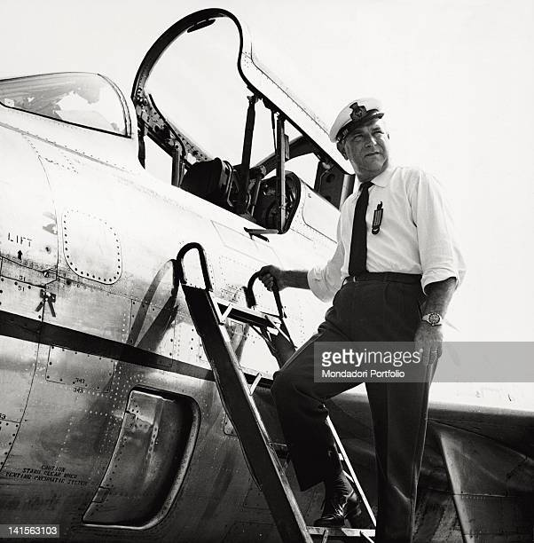 Italian Marshal Luigi Gorrini decorated with the Medaglia d'Oro during the Second World War boarding a fighter plane at an air base Giugno 1966