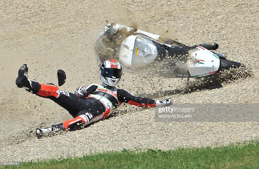 Italian Mattia Pasini rider of JIR Moto2 crashes during the Italian Grand Prix in Mugello on June 6, 2010. Spain's Marc Marquez won the race.
