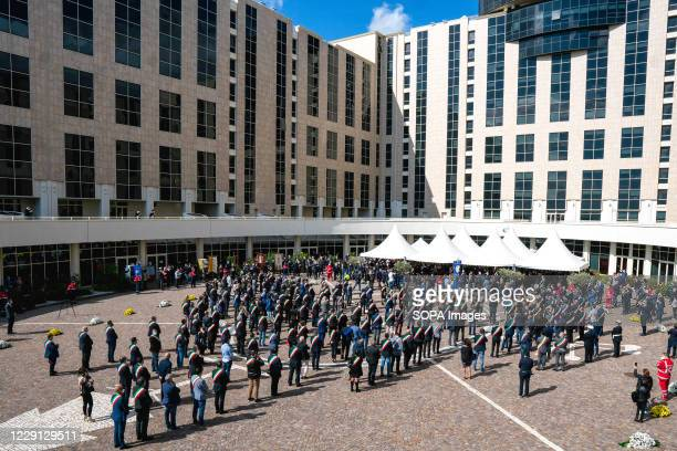 Italian mayors standing in the square during the funeral. At the Regional Citadel in Catanzaro was the last tribute for Jole Santelli, Governor of...