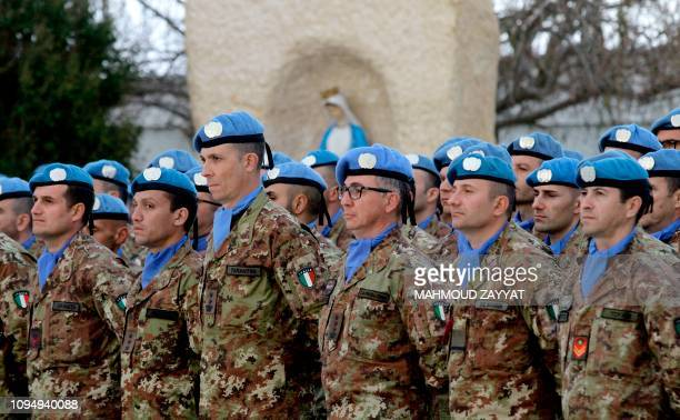 Italian members of the UN Interim Force in Lebanon stand on guard as they await their visiting prime minister at the mission headquarters in the...
