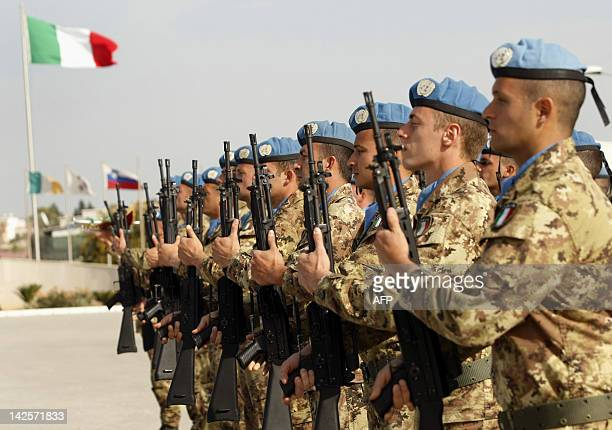 Italian members of the UN Interim Force in Lebanon stand to attention during visit of Italian Prime Minister Mario Monti at UNIFIL base in Shamaa...