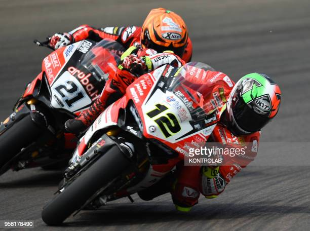 Italian Michele Rinaldi on the Ducati Panigale R of Arubait Racing Ducati challenge with teammate Spanish Xavi Fores during the Race 1 of Superbike...