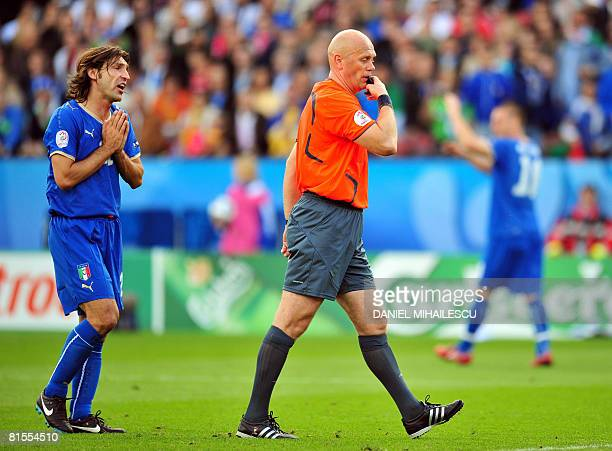 Italian midfielder Andrea Pirlo begs Norwegian referee Tom Henning during the Euro 2008 Championships Group C football match Italy vs. Romania on...