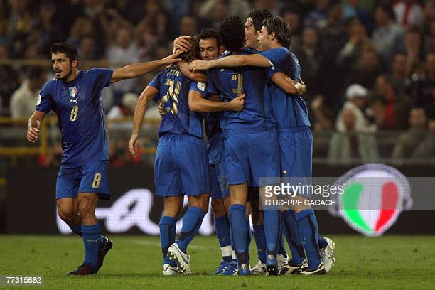 Italian midfielder Andrea Pirlo celebrates after scoring a goal with his team mates during their qualification match Italy vs Georgia for the Euro...