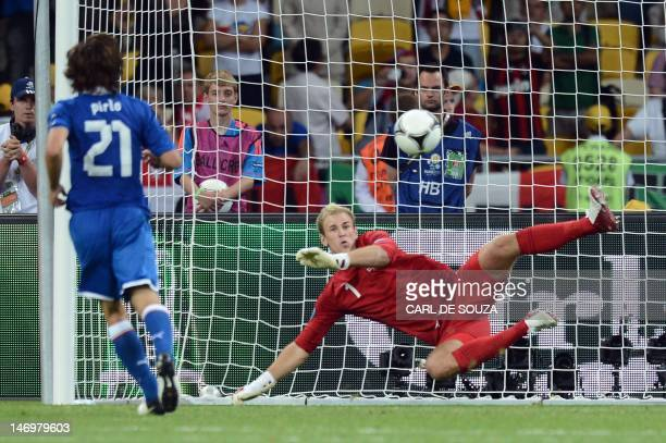 Italian midfielder Andrea Pirlo kicks and scores a penalty in the nets of English goalkeeper Joe Hart during a penalty shoot out at the Euro 2012...