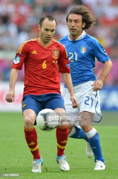 Italian midfielder Andrea Pirlo vies with Spanish midfielder Andres Iniesta during the Euro 2012 championships football match Spain vs Italy on June...