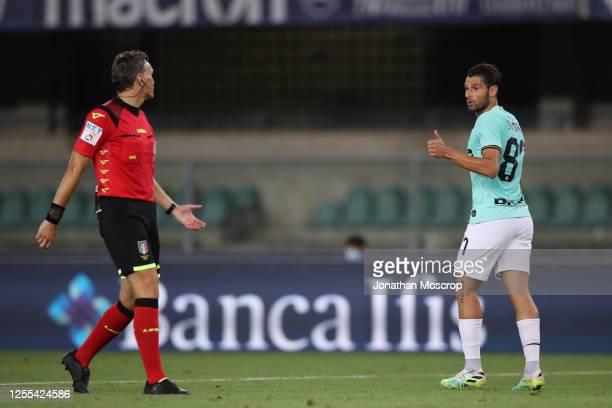 Italian midfielder Antonio Candreva acknowledges the referee Massimiliano Irrati during the Serie A match between Hellas Verona and FC Internazionale...
