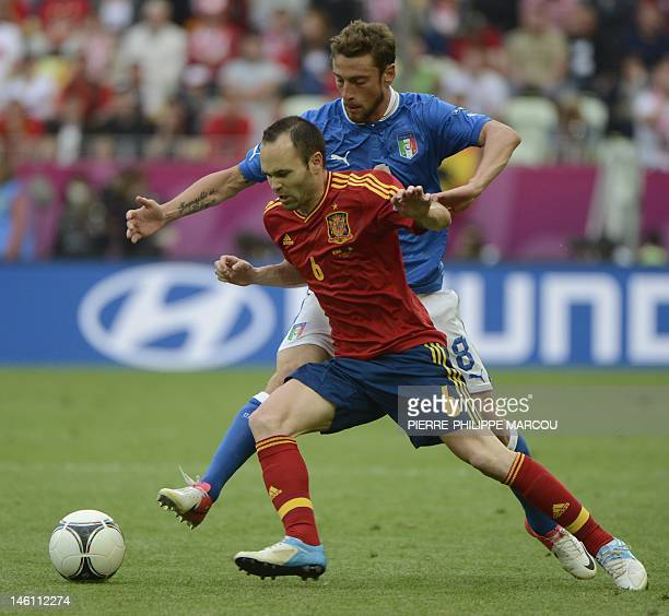 Italian midfielder Claudio Marchisio vies with Spanish midfielder Andres Iniesta during the Euro 2012 championships football match Spain vs Italy on...