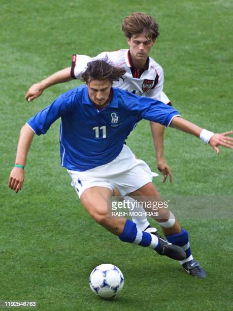 Italian midfielder Dino Baggio is chased by Austrian Hannes Reinmayr during the1998 Soccer World Cup group B first round match between Italy and...