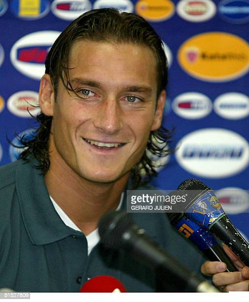 Italian midfielder Francesco Totti addresses to reporters during a press conference at the Sendai Stadium 05 June 2002 Italy who is grouped with...