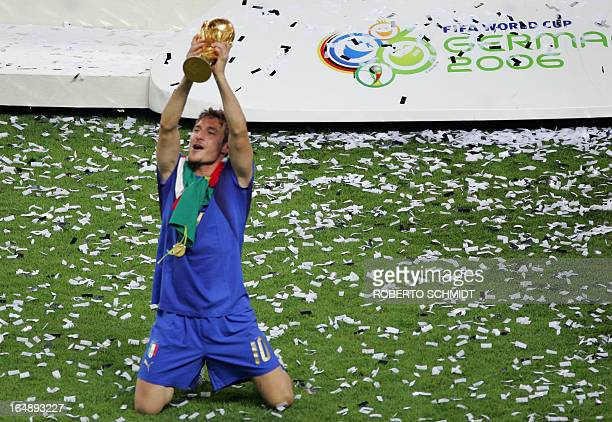 Italian midfielder Francesco Totti celebrates with the trophy after the World Cup 2006 final football game Italy vsFrance 09 July 2006 at Berlin...
