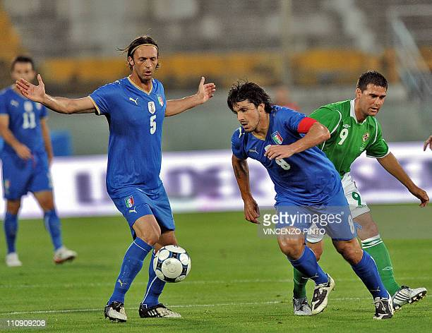 Italian midfielder Gennaro Gattuso and defender teammate Nicola Legrottaglie vie with Northern Ireland's foward David Healy during their friendly...