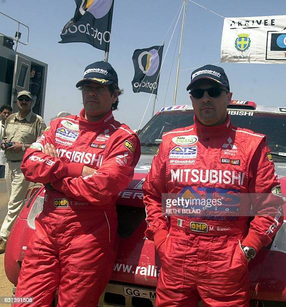 Italian Miki Biasion and codriver TSiviero pose for photographer after arriving second in the 22nd Tunisia auto rallye 13 April 2003 in ElKantara...