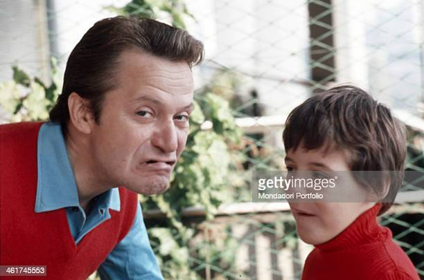 Italian mimic showman and comedian Alighiero Noschese and his son Antonello grimacing Italy 1973