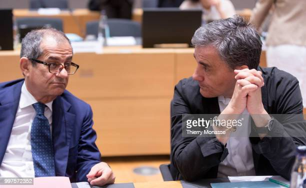 BRUSSELS BELGIUM JULY 13 Italian Minister Economy Finance Giovanni Tria is talking with the Greek Finance Minister Euclid Tsakalotos during an EU...