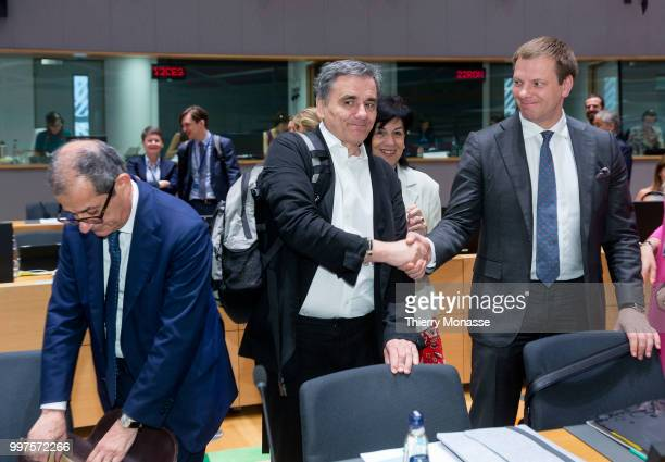 BRUSSELS BELGIUM JULY 13 Italian Minister Economy Finance Giovanni Tria the Greek Finance Minister Euclid Tsakalotos and the Lithuanian Finance...