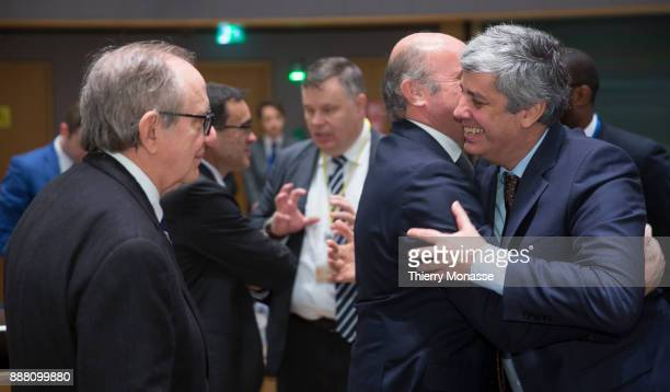 Italian Minister Economy Finance Pier Carlo Padoan is looking at the Spanish Minister of Economic Affairs Industry and Competition Luis De Guindos...