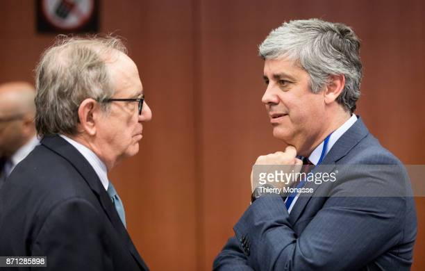 Italian Minister Economy Finance Pier Carlo Padoan is talking with the Portuguese Finance Minister Mario Centeno during an Eurozone Ministers meeting...
