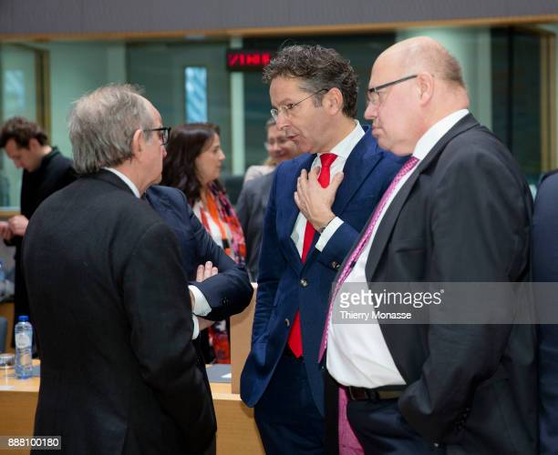 Italian Minister Economy Finance Pier Carlo Padoan is talking with the Dutch Minister of Finance President of the Council Jeroen Dijsselbloem and the...