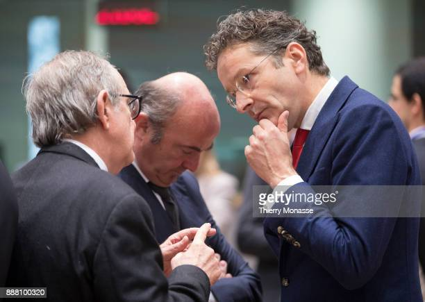 Italian Minister Economy Finance Pier Carlo Padoan is talking with the Spanish Minister of Economic Affairs Industry and Competition Luis De Guindos...