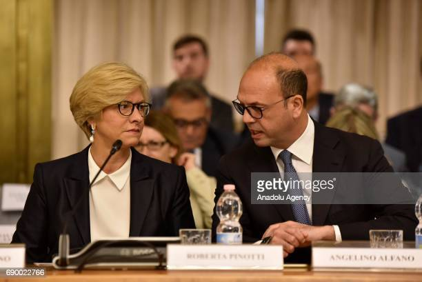 Italian Minister for Defense Roberta Pinotti and Italian Minister for Foreign Affairs Angelino Alfano attend a conference in Rome, Italy on May 30,...