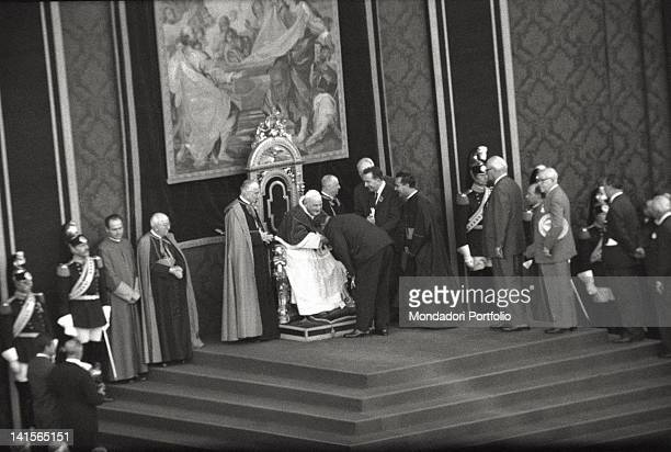 Italian Minister of Defense and President of the Organizing Committee Giulio Andreotti giving his regards to the Pontifex John XXIII Some other...