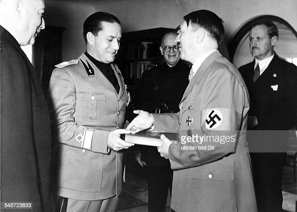 Italian Minister of Foreign Affairs Count Galeazzo Ciano on a visit to Germany Ciano at the Berghof at the Obersalzberg Adolf Hitler giving him a...