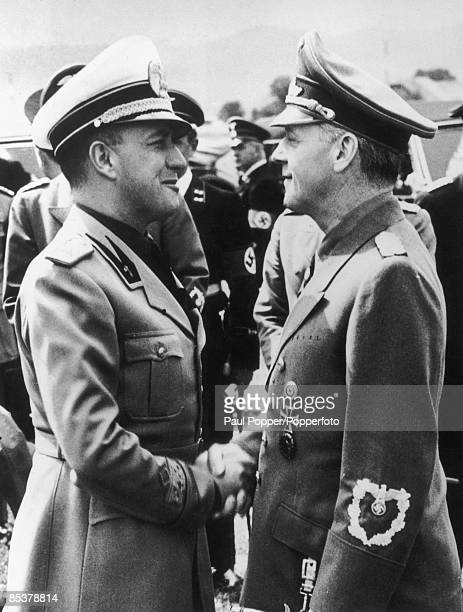Italian Minister of Foreign Affairs Count Galeazzo Ciano shakes hands with German Foreign Minister Joachim von Ribbentrop at Salzburg airport 15th...