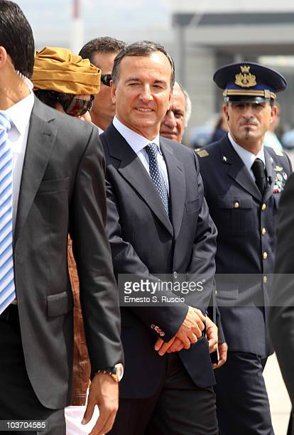 Italian Minister of Foreign Affairs Franco Frattini greets the Libyan Leader Muammar Gaddafi at the Ciampino airport on August 29 2010 in Rome Italy...