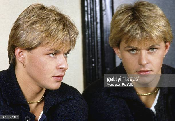 Italian model and frontman of musical project Den Harrow looking at himself in the mirror Italy 1986
