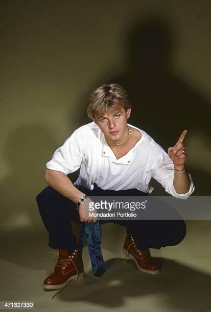 Italian model and frontman of musical project Den Harrow posing crouched Italy 1986