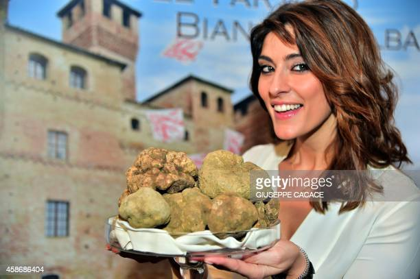 Italian model and TV host Elisa Isoardi shows white truffle during the World Alba White Truffles Auction in Grinzane Cavour in northwestern Italy on...