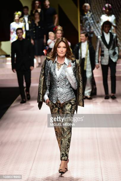 Italian model Carla Bruni Sarkozy presents a creation during the Dolce Gabbana fashion show as part of the Women's Spring/Summer 2019 fashion week in...