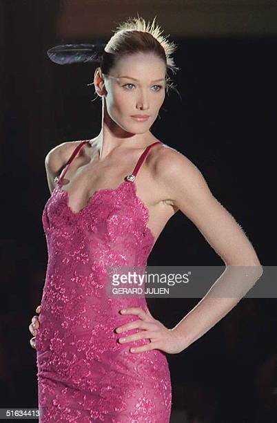 Italian model Carla Bruni shows a pink evening gown 20 January designed by Gianni Versace for the HauteCouture 1996 Spring/Summer collection in Paris...