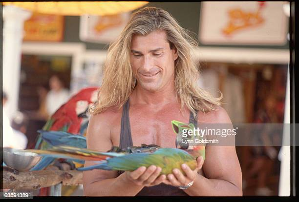 Italian model Fabio holds a sunglasseswearing parrot during a visit to Hawaii