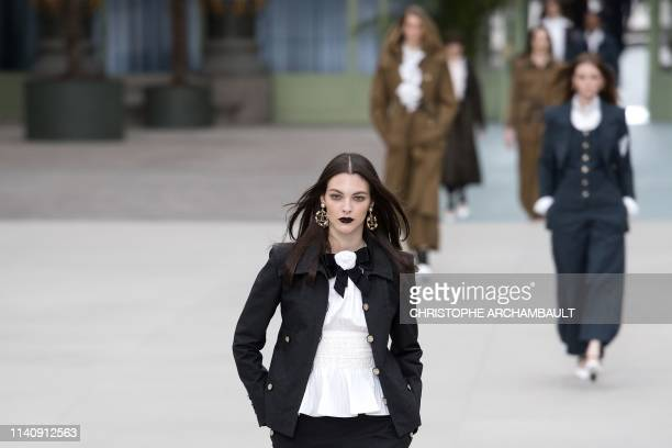 Italian model Vittoria Ceretti presents a creation during the 2020 Chanel Croisiere fashion show at the Grand Palais in Paris on May 3, 2019.