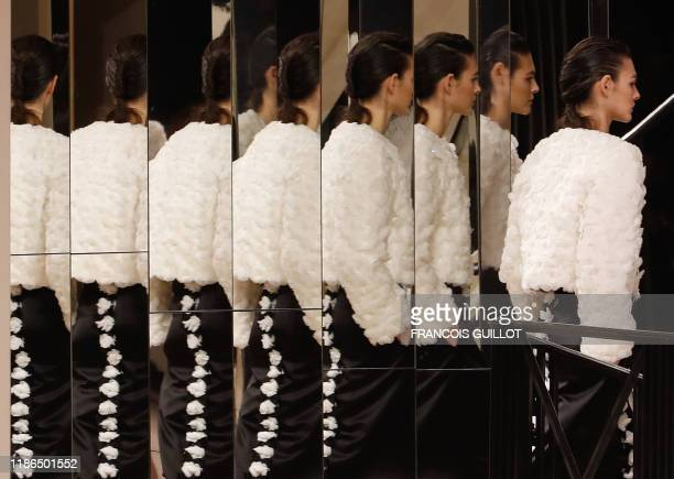 TOPSHOT Italian model Vittoria Ceretti presents a creation during the Chanel Metiers d'art 20192020 show at Le Grand Palais on December 4 in Paris...