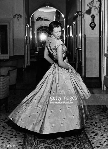 Italian model wearing a grey taffeta 'Veneziani' dress with slightly damask patterns Stresa 1949