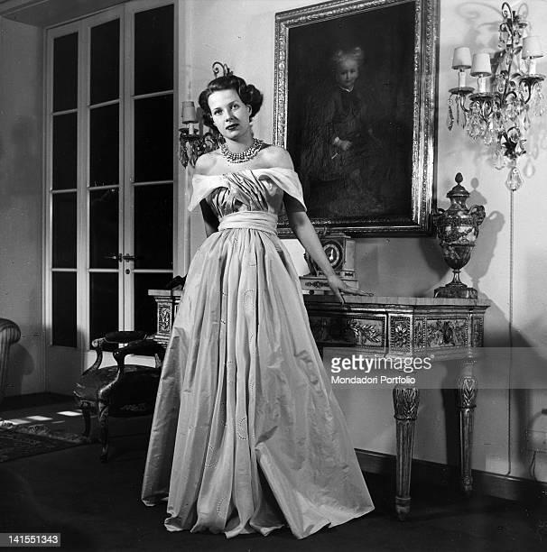 Italian model wearing a silk muslin 'Biki' dress with taffeta belt Italy 1949