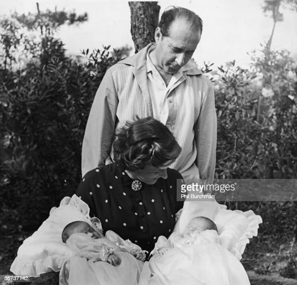 Italian motion picture director Roberto Rossellini looks over the shoulder of his second wife Swedish actress Ingrid Bergman at his two twin...