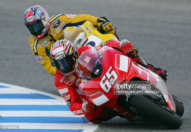 Italian Moto GP rider Loris Capirossi takes a curve followed by Colin Edwards of the US in Jerez 25 March 2006 during the free practice session...