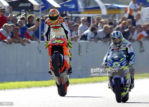 Italian Moto GP rider Valentino Rossi with his Honda GP pops a wheelie after winning the Moto Grand Prix of Comunidad Valenciana in Moto GP category...