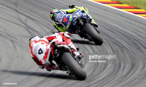 Italian Moto3 drivers Enea Bastianini and Fabio Di Giannantonio both of the Gresini Racing Moto3 Team drive on the course during the qualifying at...