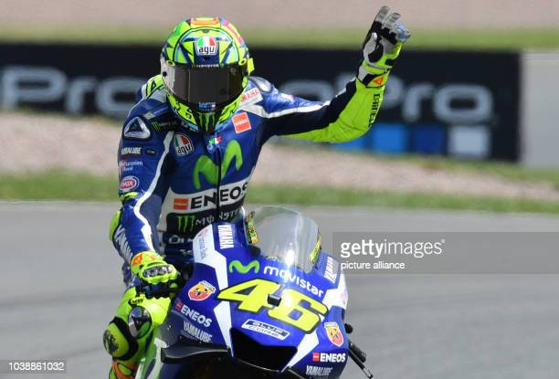Italian MotoGP driver Valentino Rossi of the team Movistar Yamaha MotoGP waves after the qualifying at Motorcycling World Championships Grand Prix...