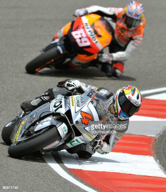 Italian MotoGP rider Andrea Dovizioso of Repsol Honda leads US MotoGP rider Nicky Hayden of Repsol Honda round a corner during the third free...