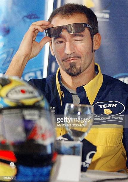 Italian MotoGP rider Maximiliano Biaggi answers a question 16 September during a HondaPons team press conference in Rio de Janeiro Brazil Biaggi who...