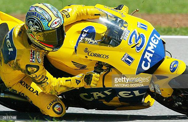Italian MotoGP rider Maximiliano Biaggi negotiates a turn on his Honda Pons 19 September 2003 during the second training session at the Nelson Piquet...