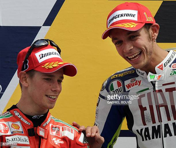 Italian MotoGP rider Valentino Rossi chats with Australian Casey Stoner on the podium of the Red Bull US Grand Prix in Laguna Seca California July 20...