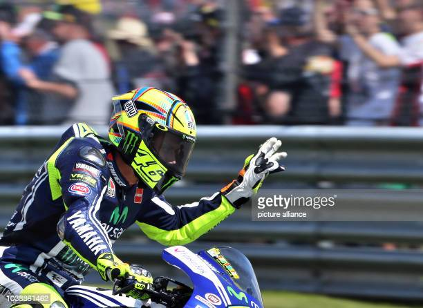 Italian MotoGP rider Valentino Rossi of team Moviestar Yamaha cheers after the qualifying of the motorcycling Grand Prix of Germany at Sachsenring in...